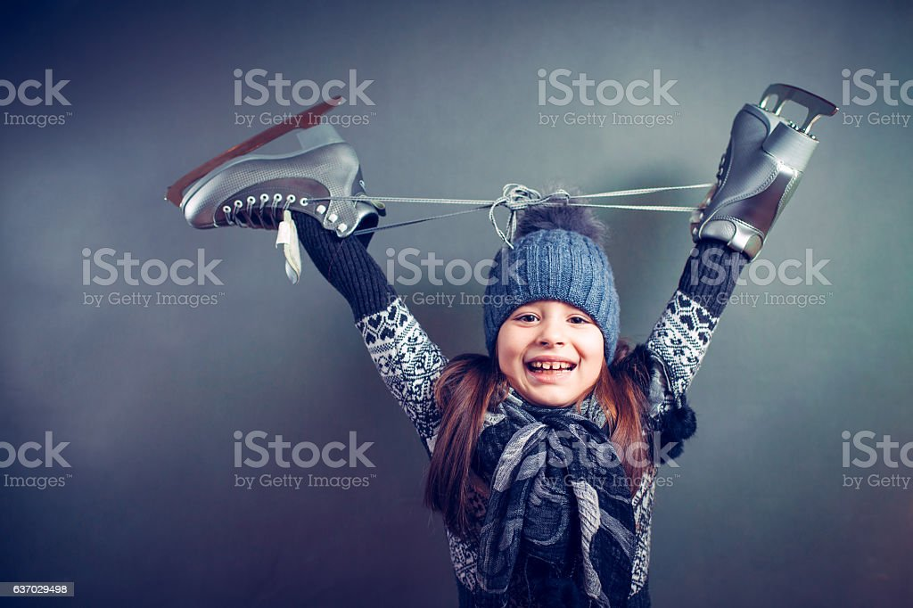 Little girl with skates isolated on background stock photo