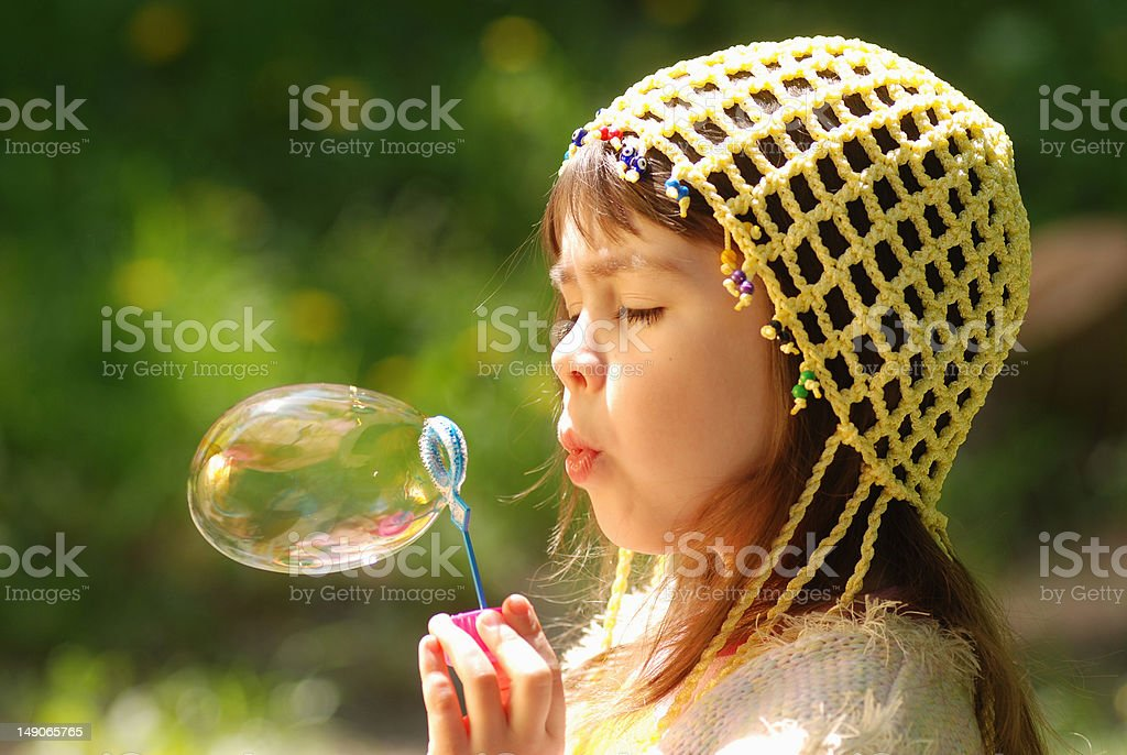 Little girl with soap bubbles royalty-free stock photo