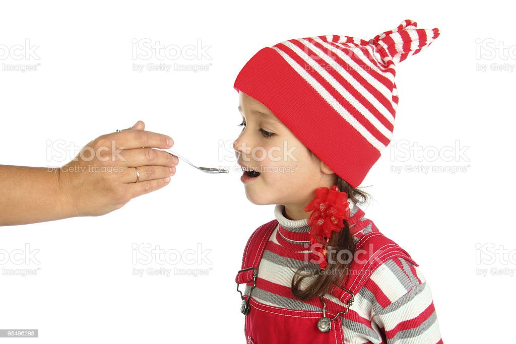 little girl with spoon in opened mouth royalty-free stock photo