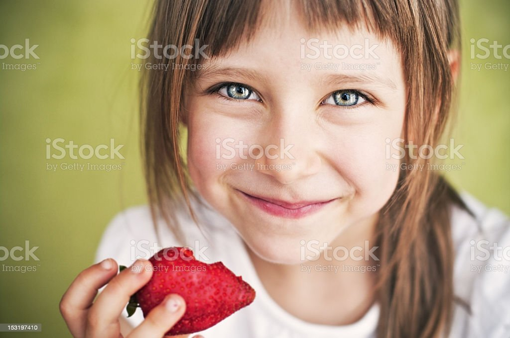 Little girl with strawberry stock photo