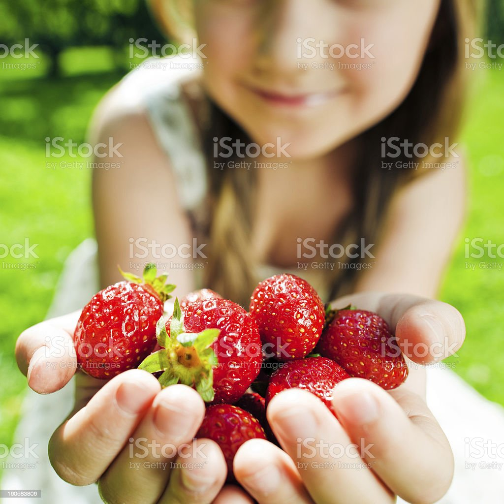 Little girl with strawberry royalty-free stock photo