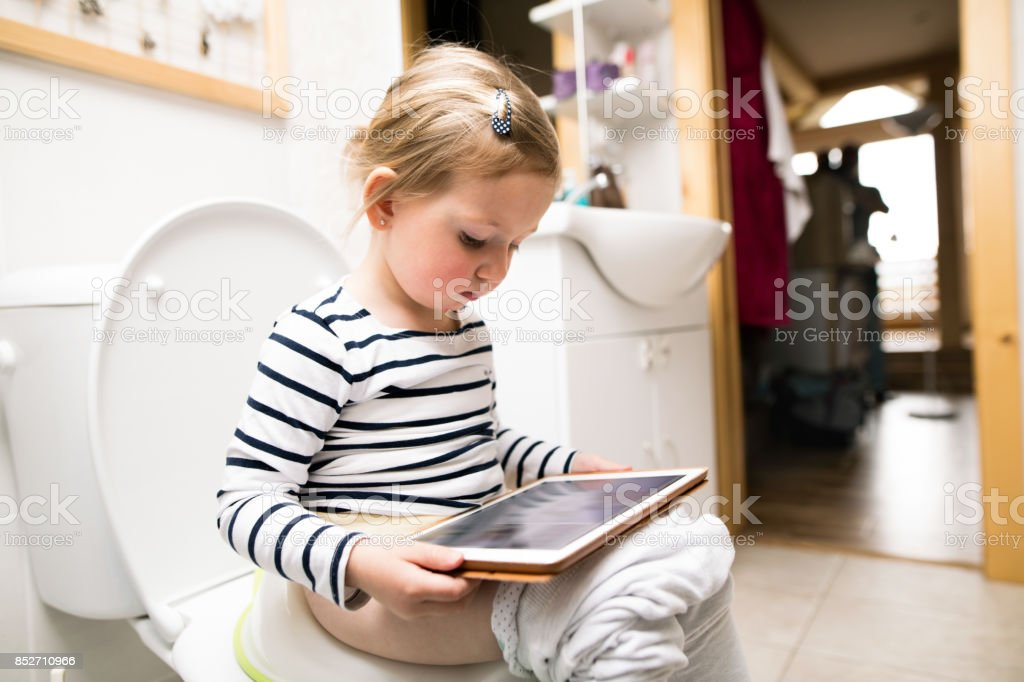 Girl sitting on toilet stock photo. Image of health, bowl