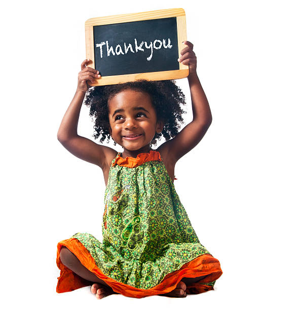 Little girl with thankyou sign stock photo