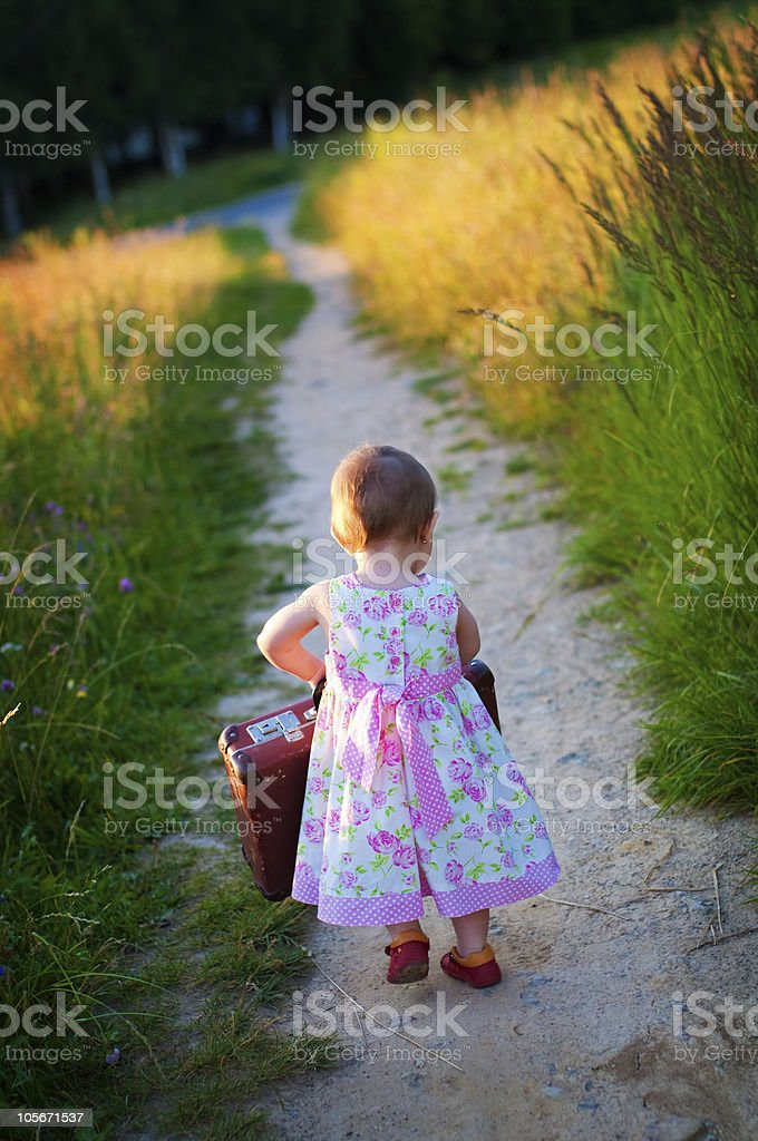 Little girl with the big  luggage royalty-free stock photo