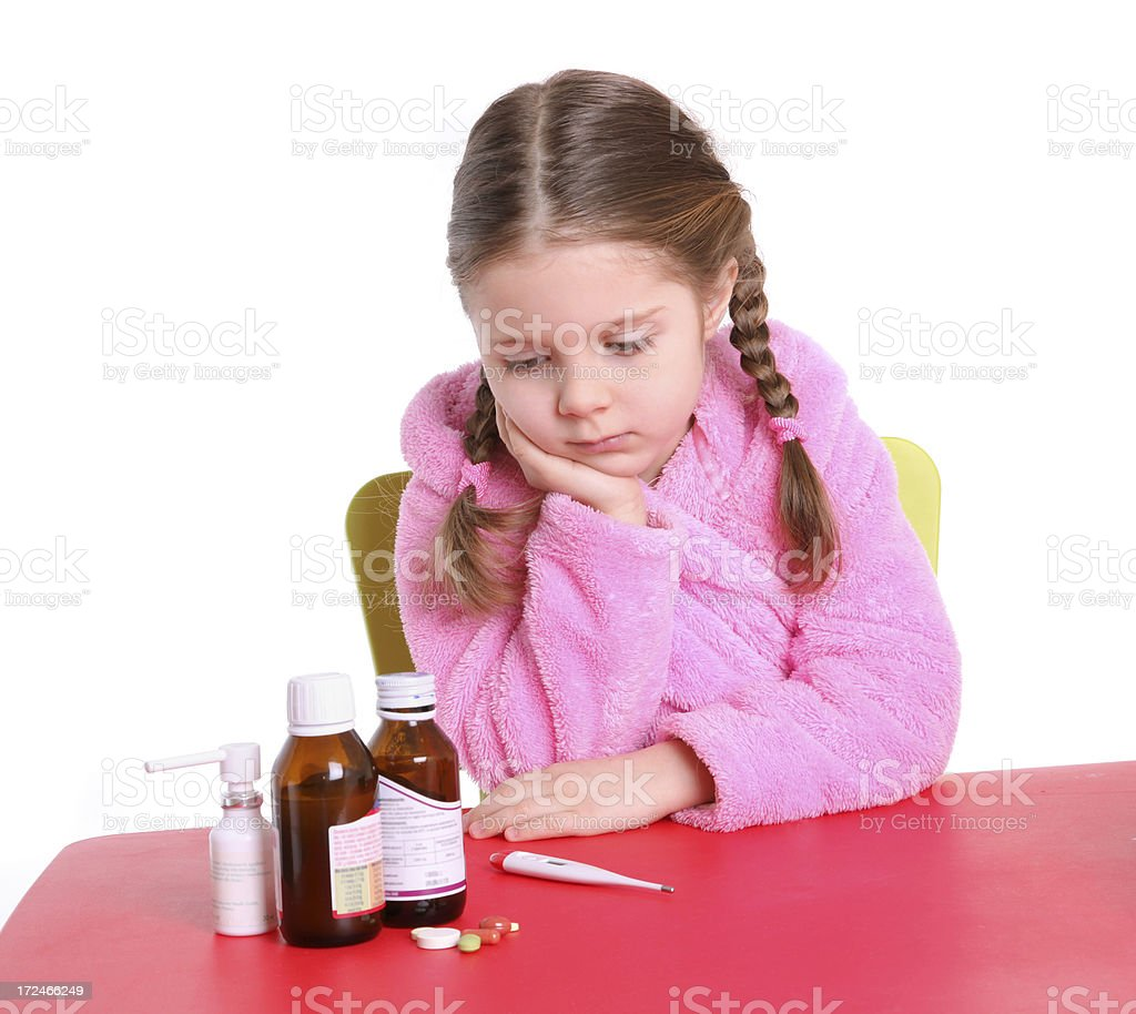 Little girl with the flu stock photo