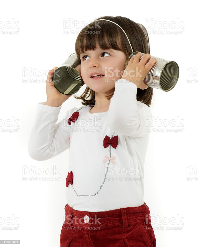 little girl with tin can phone royalty-free stock photo