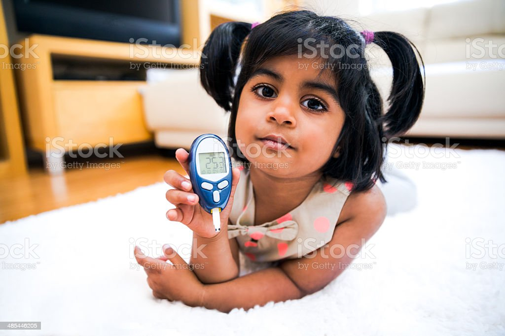 Little Girl with Type I Diabetes stock photo