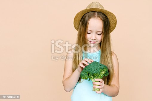 istock Little girl with vegetables. 867386726