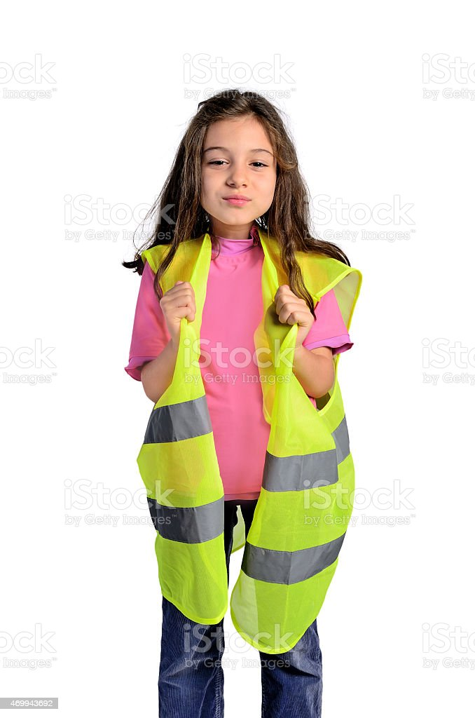 little girl with visibility vest stock photo
