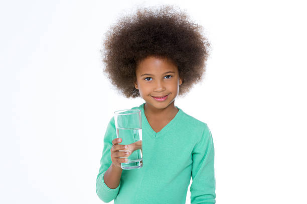 little girl with water stock photo