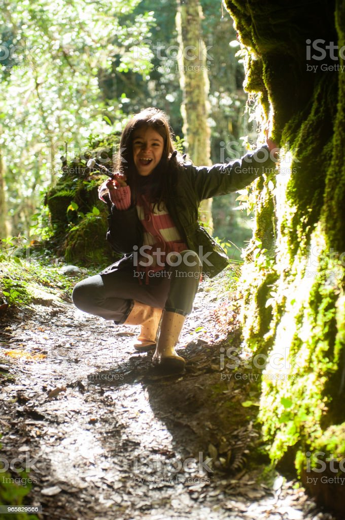 Little girl with winter clothes at the entrance of the cave in Urubici, Santa Catarina, Brazil - Royalty-free Agricultural Field Stock Photo