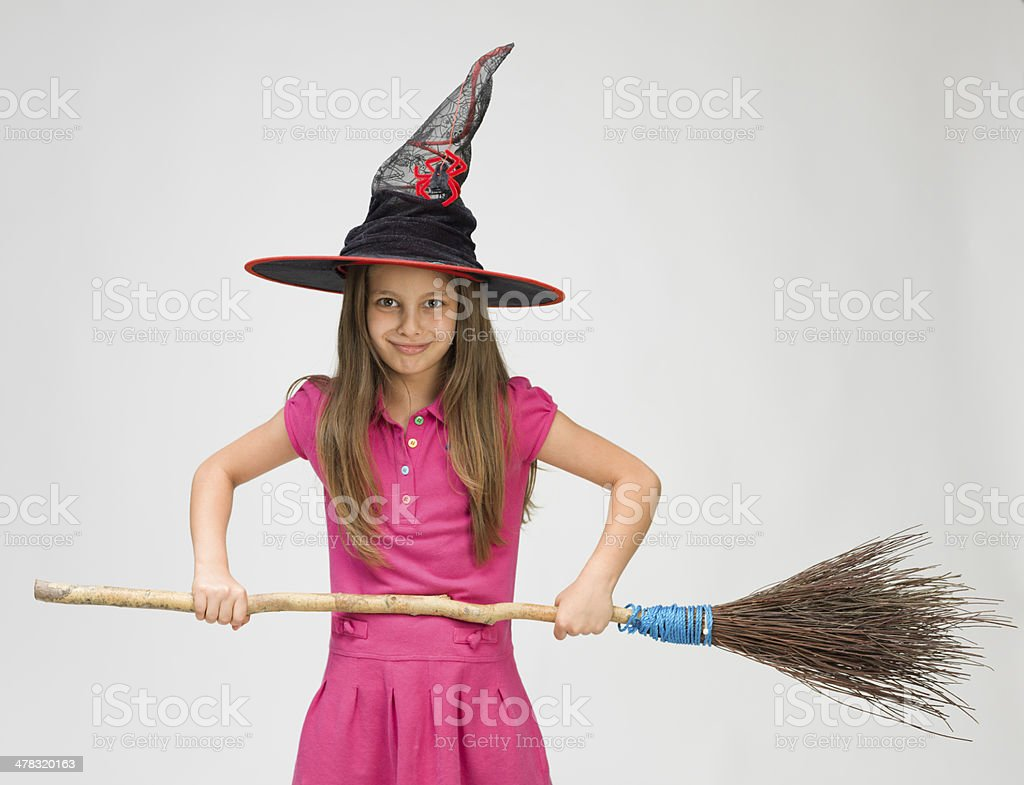 Little girl with witch's hat and real broom royalty-free stock photo
