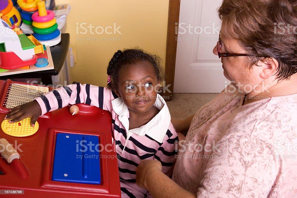 Little girl working at sensory station stock photo
