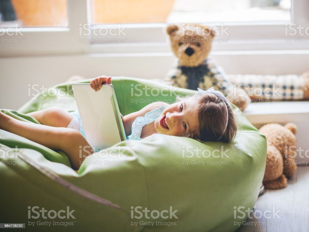 Little Girl Working On Her Digital Tablet royalty-free stock photo