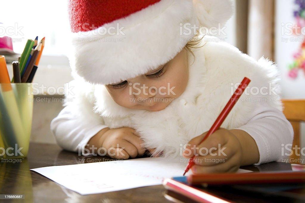Little girl writes letter to Santa royalty-free stock photo