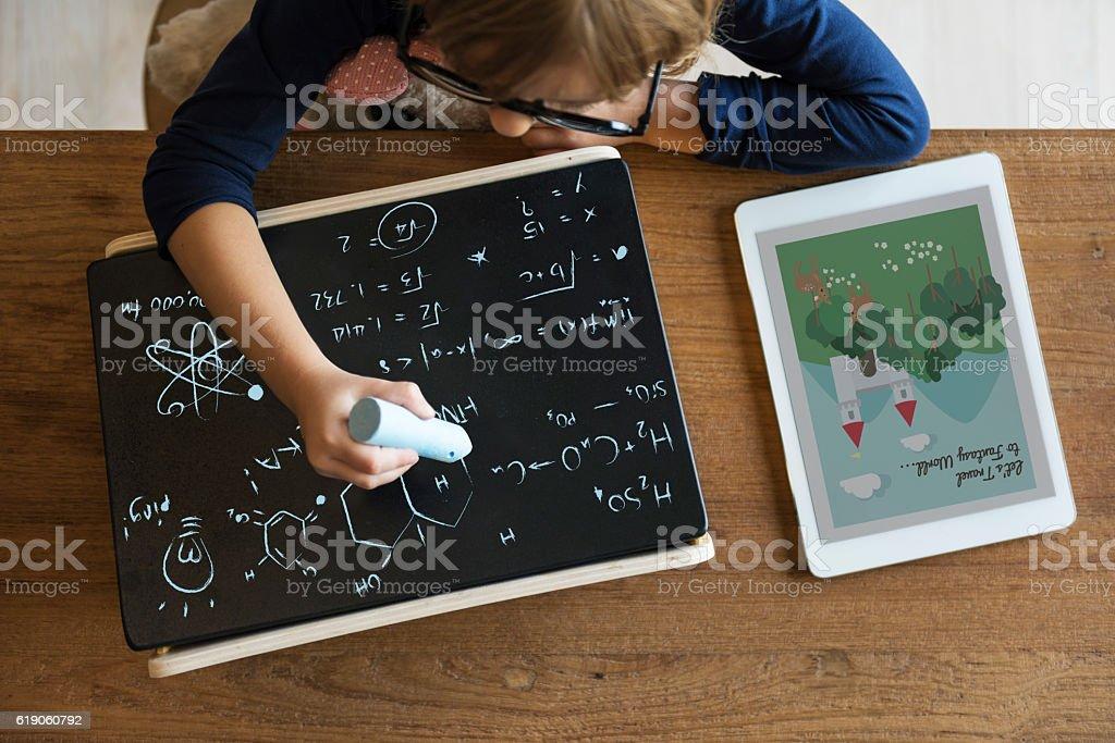 Little Girl Writing Blackboard Concept foto de stock libre de derechos