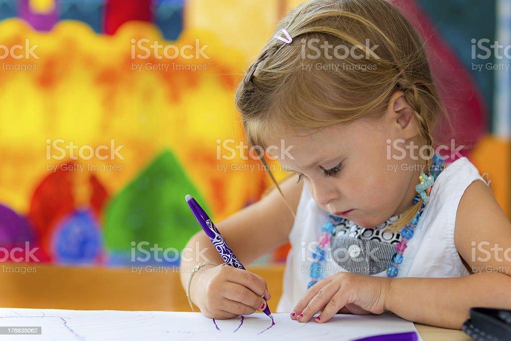 little girl writing stock photo