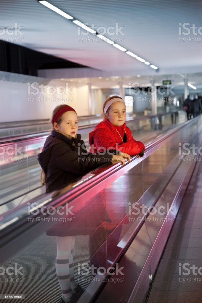 Little girls alone at the airport  6-7 Years Stock Photo