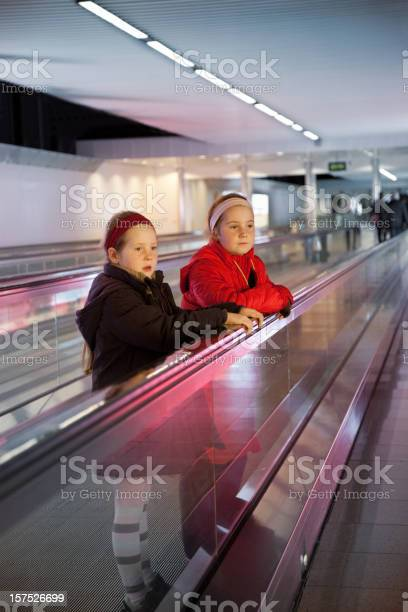 Little Girls Alone At The Airport Stock Photo - Download Image Now