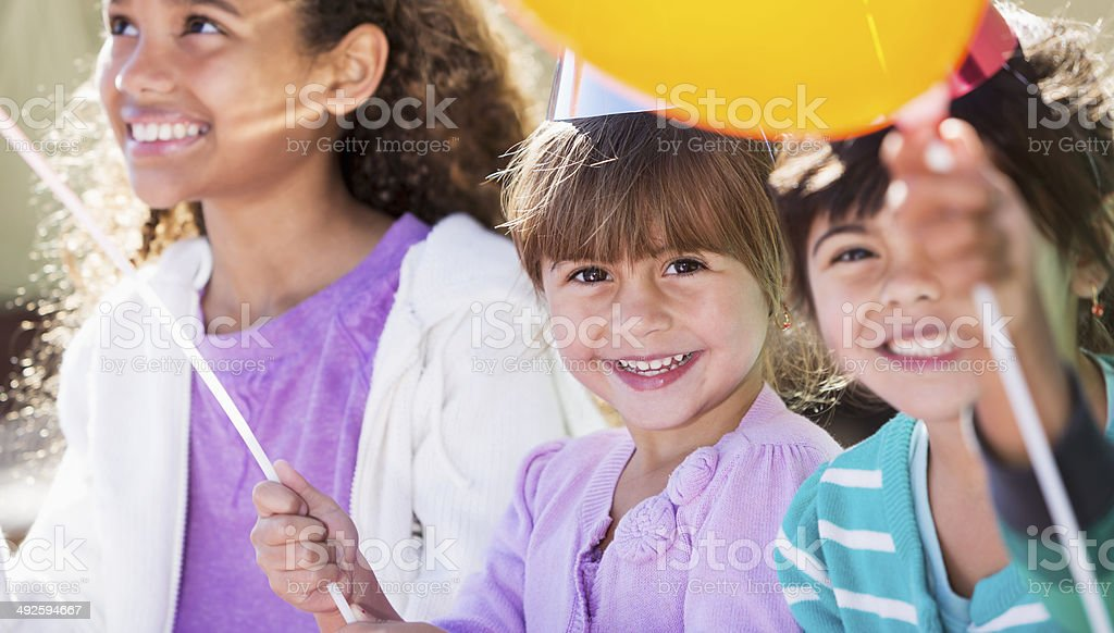 Little girls at a party stock photo