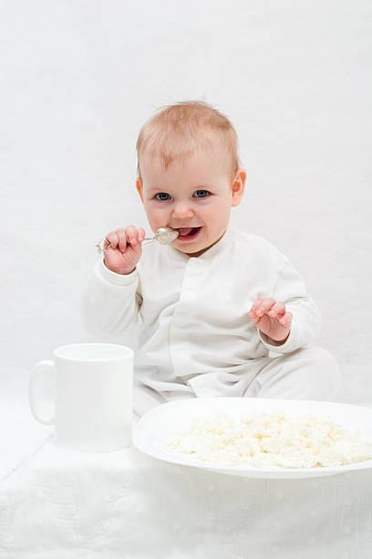 little girl's breakfast stock photo