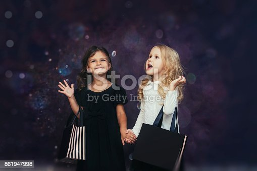 istock Little girls child fashion with paper bags on a background with highlights cute and beautiful 861947998