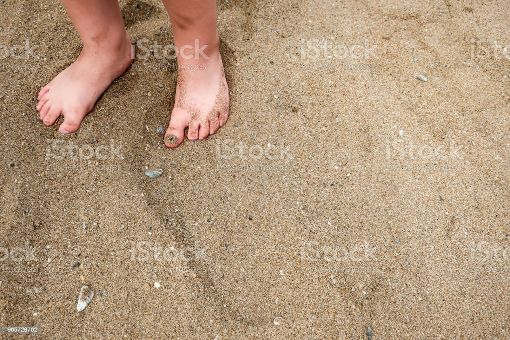 A little girl's / child's feet in the sand on a beach - Royalty-free Barefoot Stock Photo