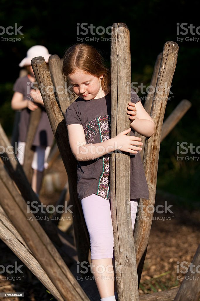 """Little girls climbing a recreational circuit """"7 and 9 year old girls, balancing a health/recreational parcours."""" 6-7 Years Stock Photo"""