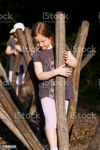 Little Girls Climbing A Recreational Circuit Stock Photo - Download Image Now