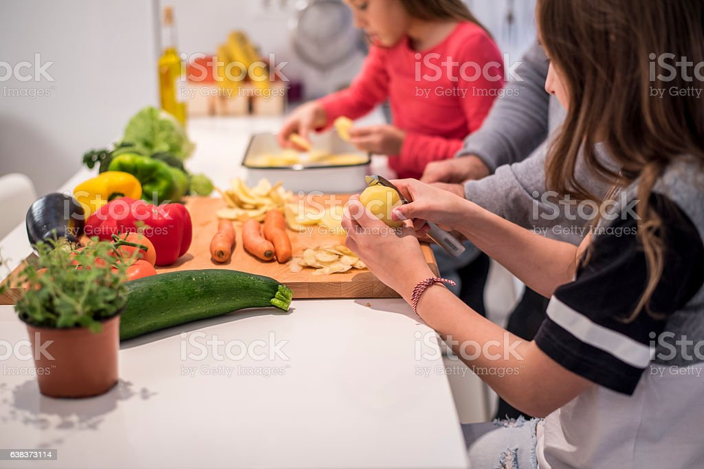 Little girls cooking with their father stock photo