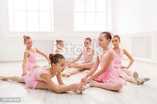 istock Little girls dancing ballet in studio 831682636
