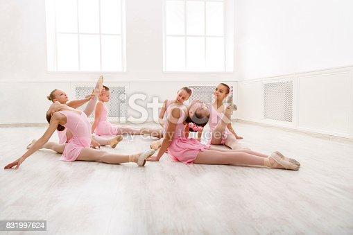 905560090 istock photo Little girls dancing ballet in studio 831997624