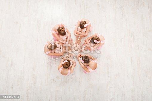 istock Little girls dancing ballet in studio, top view 814447524