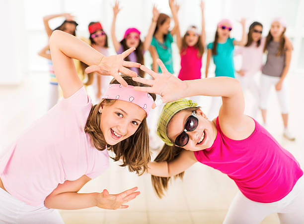 little girls dancing. - dance group stock photos and pictures