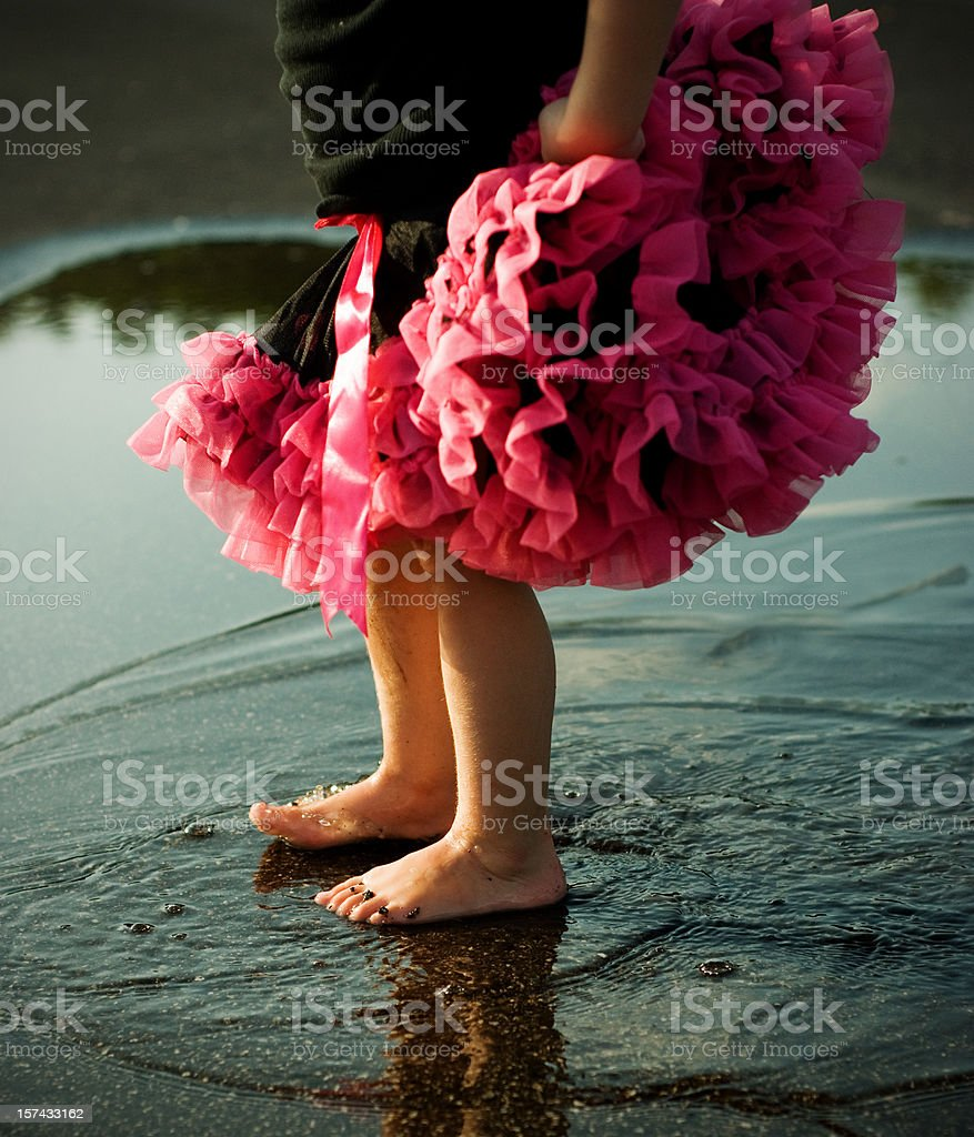 Little Girls Feet Splashing and Dancing in Puddle stock photo