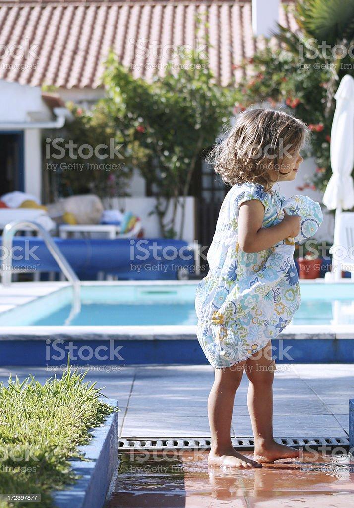 Little Girls Feet Splashing in Puddle stock photo