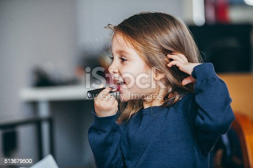 istock Little girl's first lipstick 513679500