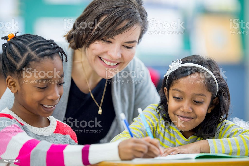Little Girls Happily Working in Class stock photo