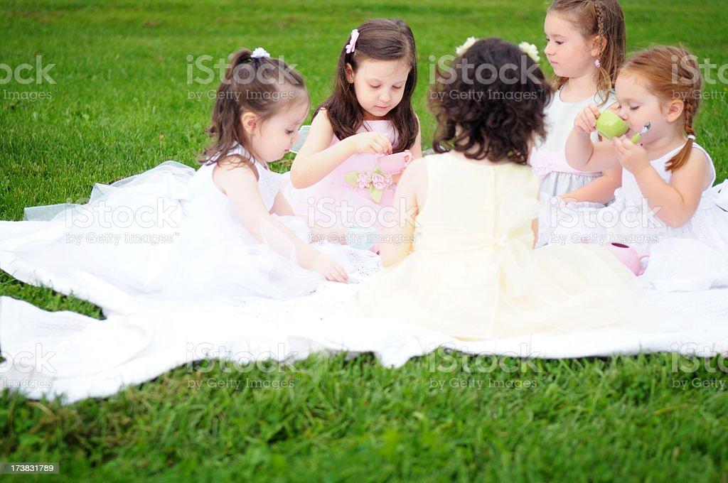 Little Girls Having a Princess Tea Party Outside royalty-free stock photo