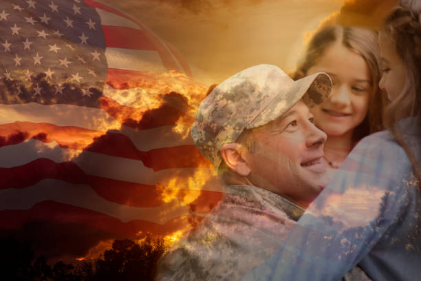 Little girls hug military father overlay sunset, American flag. Little girls give military father big hugs to welcome him home overlay on dramatic sunset sky and waving American flag. family 4th of july photos stock pictures, royalty-free photos & images