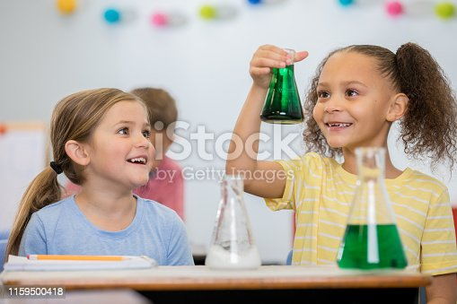 istock Little girls in elementary STEM class are doing a simple science experiment together 1159500418