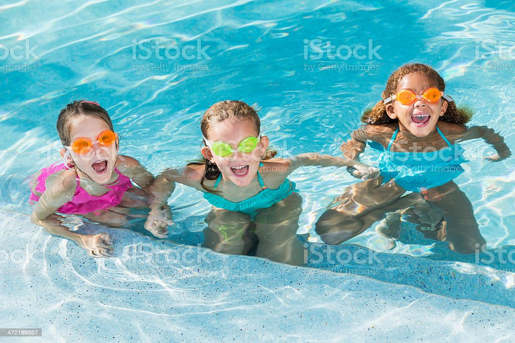 Little girls in swimming pool stock photo