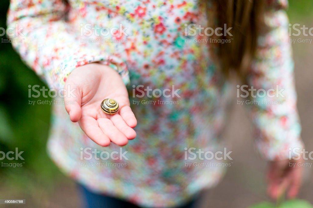 Little girls like snails too. stock photo