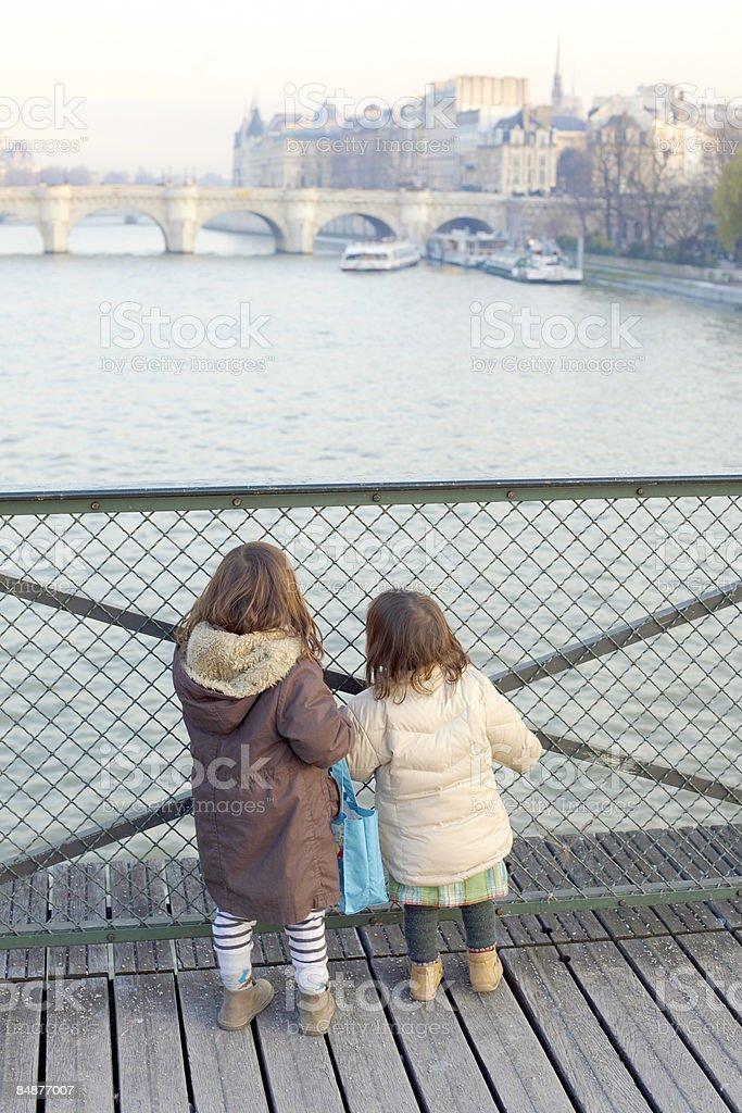 2 little girls on a paris bridge royalty-free stock photo