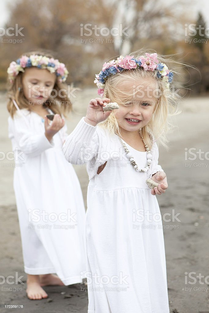 Little Girls on Beach With Flowers in Hair royalty-free stock photo
