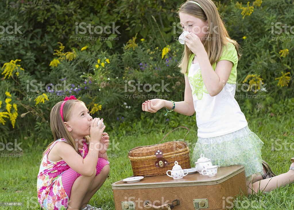 Little girls outdoor tea party royalty-free stock photo