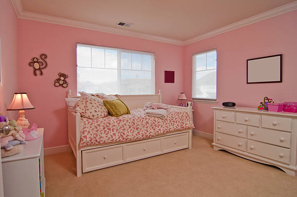 Little Girl's Pink Bedroom Little Girl's Pink Bedroom girl bedroom stock pictures, royalty-free photos & images