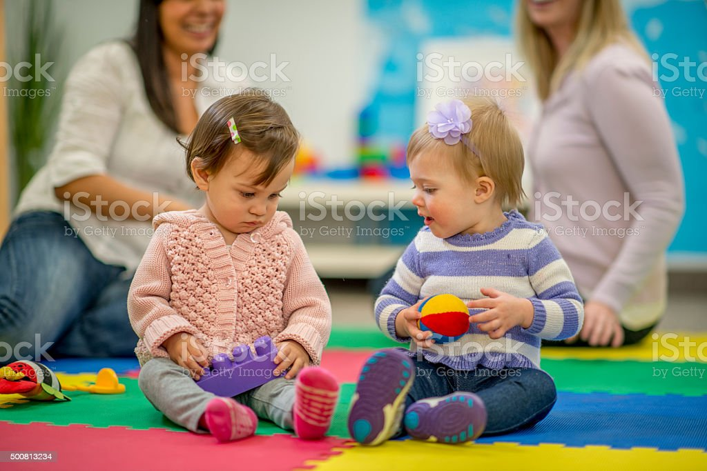 Little Girls Playing at Preschool stock photo