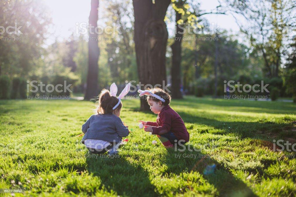 Little girls playing on grass stock photo