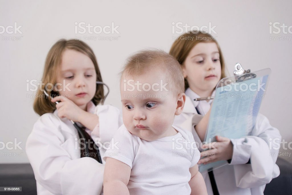Little girls playing stock photo